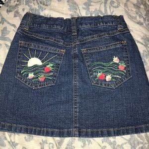 Denim skirt with strawberry detail